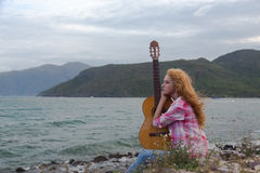 The girl with a guitar. royalty free stock photography