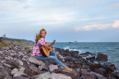 The girl with a guitar. royalty free stock photo