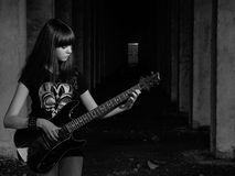 Girl with guitar. Beautiful young girl playing the guitar on the ruins royalty free stock photos