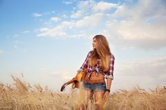 Girl with guitar in the field Royalty Free Stock Images