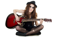 The girl with a guitar - grunge style Stock Image