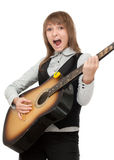 Girl with guitar in hand expressive sings Royalty Free Stock Photo