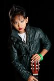 Girl with a guitar in his leather jacket Royalty Free Stock Photography