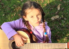 Girl with a guitar Royalty Free Stock Photo
