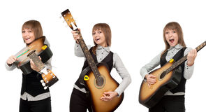 Girl with guitar in miscellaneous pose Stock Photos