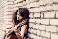 Girl with guitar outdoor. Beautiful girl with guitar outdoor royalty free stock images