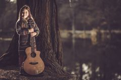 Girl With Guitar in the Park Stock Photo