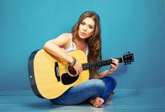 Girl guitar play and sings. Young model sitting on a floor. teenager style portrait Stock Photo