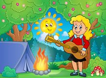 Girl guitar player in campsite theme 1 Royalty Free Stock Photography