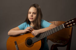 Girl with guitar Royalty Free Stock Photos