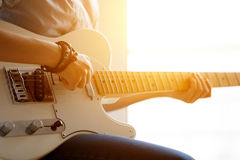 Girl with guitar. Silhouette of a girl with a guitar near the window Royalty Free Stock Photo