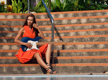 The girl with guitar is sitting on the steps Royalty Free Stock Photo