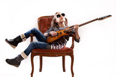 Girl with guitar and sunglasses Stock Images