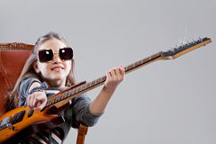 Girl with guitar and sunglasses Royalty Free Stock Photography