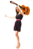 Girl with guitar thumbing and hitch hiking isolated Royalty Free Stock Photos