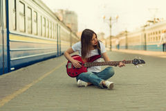 Girl with a guitar Royalty Free Stock Photography