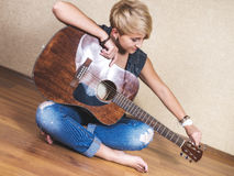 Girl with the guitar Stock Photography