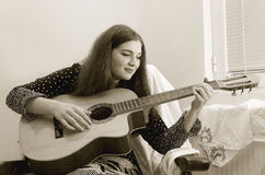 Girl with guitar. Young girl playing classic guitar Royalty Free Stock Photo