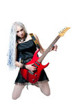 Girl guitarist with red guitar Royalty Free Stock Images