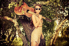 Girl guitarist stock photography