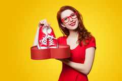 Girl with gumshoes and gift box Royalty Free Stock Images