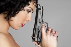 Girl With Gun. Sad thinking girl with gun stock image