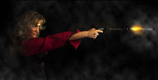 Girl  with a gun. Portrait of a young girl in a red shirt with a gun Stock Photos
