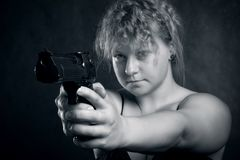 Girl with gun Royalty Free Stock Image