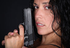 Girl with Gun. Girl looking holding a gun Stock Images