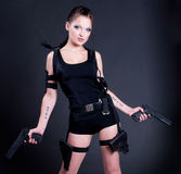 Girl with gun. Beautiful girl with gun on dark background Stock Photos