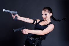 Girl with gun. Beautiful girl with gun on dark background Royalty Free Stock Images