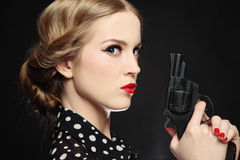 Girl with gun Stock Photo