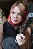 A girl and a gun Royalty Free Stock Image
