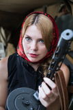 A girl and a gun Royalty Free Stock Photo