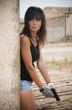 Girl with gun. Beautifull girl with a small gun Royalty Free Stock Image