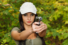 The girl with the gun Royalty Free Stock Images
