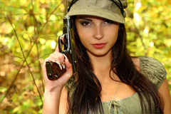The girl with the gun Stock Photos
