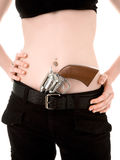Girl with a gun. Girl's stomach with a gun under belt Stock Photo