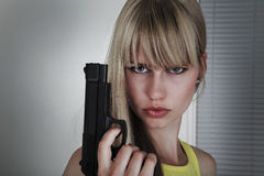 Girl gun action Stock Photos