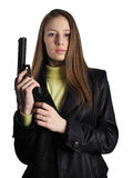 The girl with a gun. The beautiful girl dressed in black cloak with gun on a white background Royalty Free Stock Images
