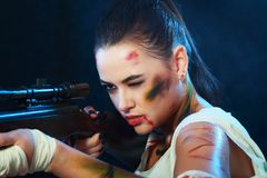 Girl with gun Royalty Free Stock Photos