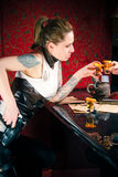 Girl with a gun drinking tequila Royalty Free Stock Images