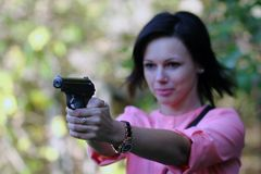 Girl with gun. The girl with gun. Focus on gun royalty free stock photography