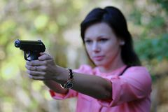 Girl with gun. The girl with gun. Focus on gun stock images