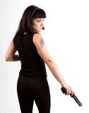 Girl with gun and headphones. Sexi girl in black dress with gun and headphones Royalty Free Stock Photos