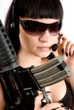 Girl with gun and headphones. Sexi girl in black dress with gun and headphones Stock Photography