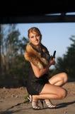 Girl. With a gun in his hand and collar fox Stock Photos