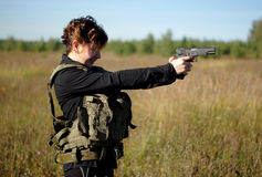 A girl with a gun in his hands Stock Images