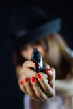Girl with gun Stock Images
