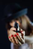 Girl with gun. Girl holds gun stock images